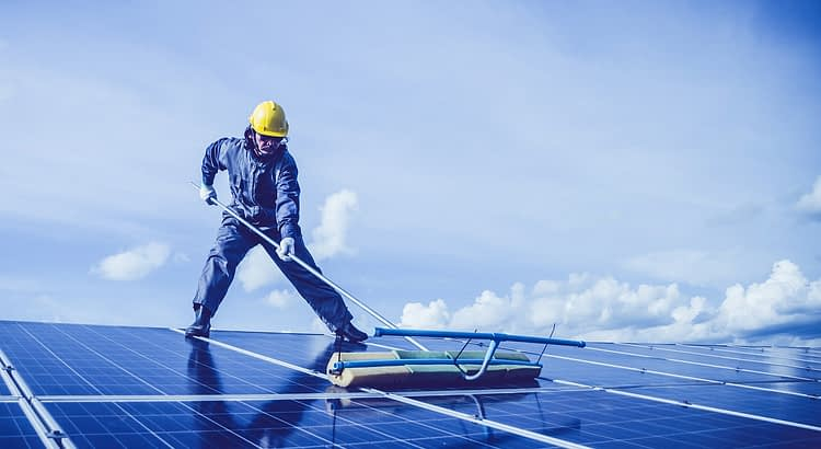 Man Solar Panel Rooftop Cleaning  - maddybris / Pixabay